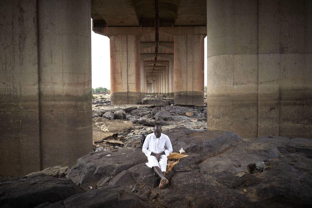 An imam is seen meditating under the third bridge at the mosque in Bamako, Mali, during the Eid al-Fitr, the holiday that marks the end of the Holy Month of Ramadan, on 12 May 2021.