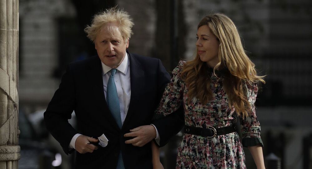 British Prime Minister Boris Johnson arrives at a polling station with his partner Carrie Symonds to cast his vote in local council elections in London, Thursday May 6, 2021
