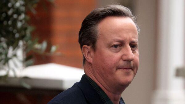 Former British Prime Minister David Cameron leaves his home in London - Sputnik International