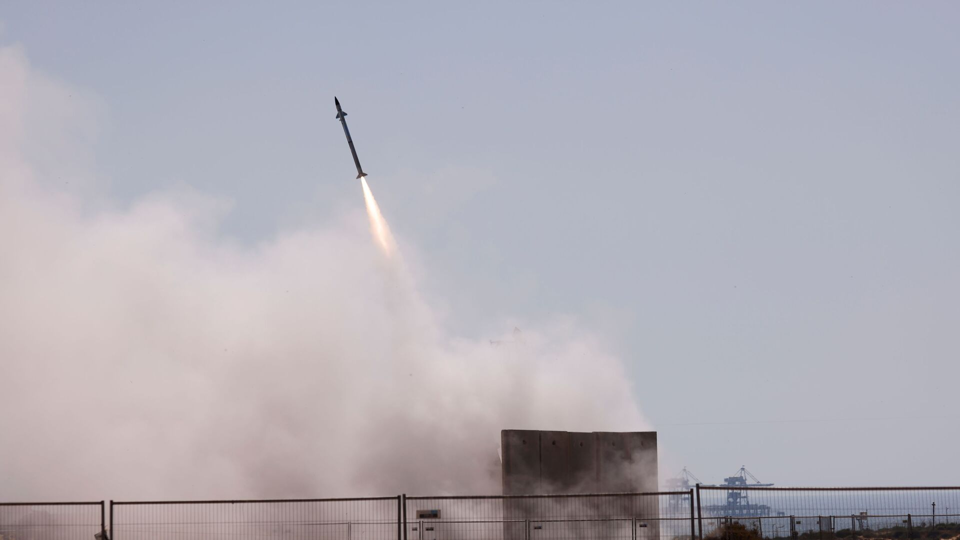 Israel's Iron Dome anti-missile system fires to intercept a rocket launched from the Gaza Strip towards Israel, as seen from Ashkelon, Israel May 12, 2021 - Sputnik International, 1920, 11.09.2021
