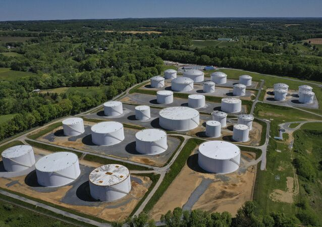 In an aerial view, fuel holding tanks are seen at Colonial Pipeline's Dorsey Junction Station on May 13, 2021 in Washington, DC. The Colonial Pipeline has returned to operations following a cyberattack that disrupted gas supply for the eastern U.S. for days.