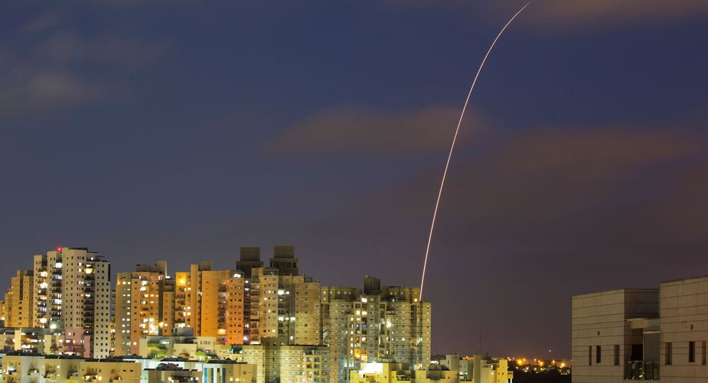 A streak of light is seen as Israel's Iron Dome anti-missile system try to intercept rockets launched from the Gaza Strip towards Israel, as seen from Ashkelon, Israel May 13, 2021. REUTERS/Amir Cohen