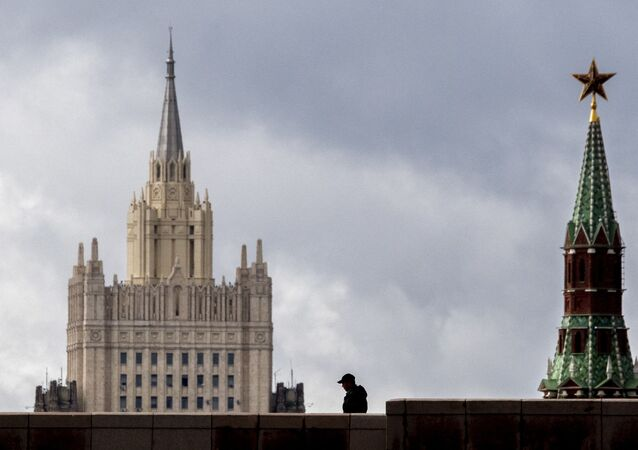 A man walks in front of a tower of the Kremlin and the Russian Foreign Ministry building in central Moscow on September 10, 2020.