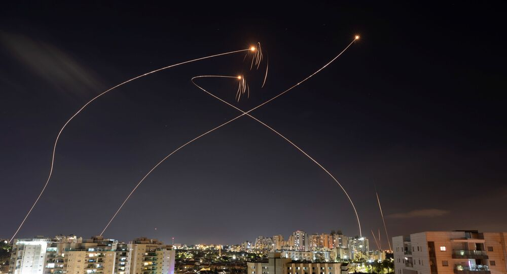 Streaks of light are seen as Israel's Iron Dome anti-missile system intercept rockets launched from the Gaza Strip towards Israel, as seen from Ashkelon, Israel May 13, 2021.