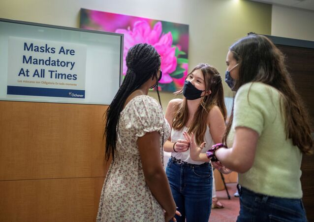 Croix Hill, 15, left Ava Kreutziger, 14 and Lilly Gorman, 15, wait to receive their first dose of the COVID-19 vaccine at the Ochsner Center for Primary Care and Wellness, after the Centers for Disease Control and Prevention recommended the Pfizer vaccine for use in teenagers ages 12 to 15 in New Orleans, Louisiana, U.S., May 13, 2021.