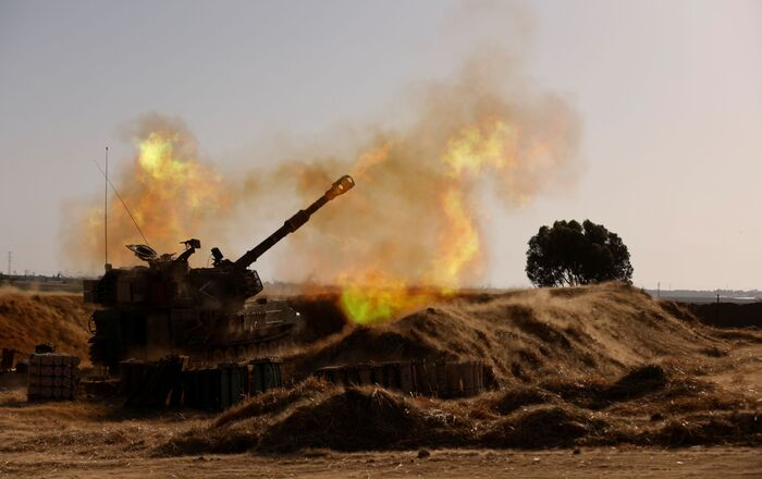 An Israeli mobile artillery unit fires near the border between Israel and the Gaza Strip, May 12, 2021