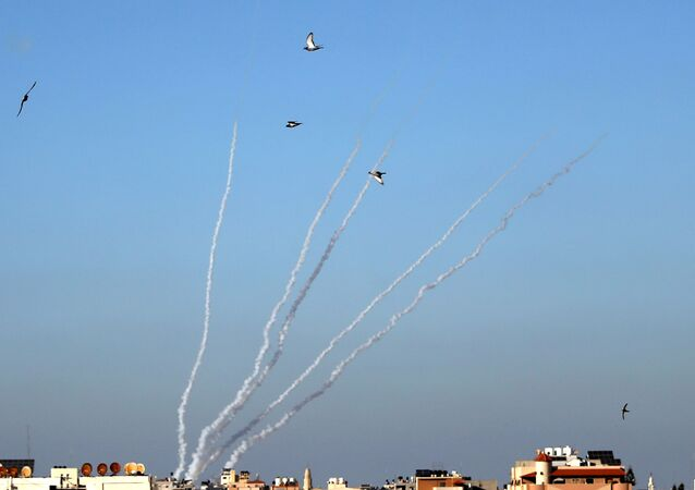 Rockets are launched by Palestinian militants into Israel, in Gaza May 13, 2021.