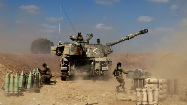 Israeli soldiers fire a 155mm self-propelled howitzer towards the Gaza Strip from their position near the southern Israeli city of Sderot on May 13, 2021. - Israel faced an escalating conflict on two fronts, scrambling to quell riots between Arabs and Jews on its own streets after days of exchanging deadly fire with Palestinian militants in Gaza. - Sputnik International