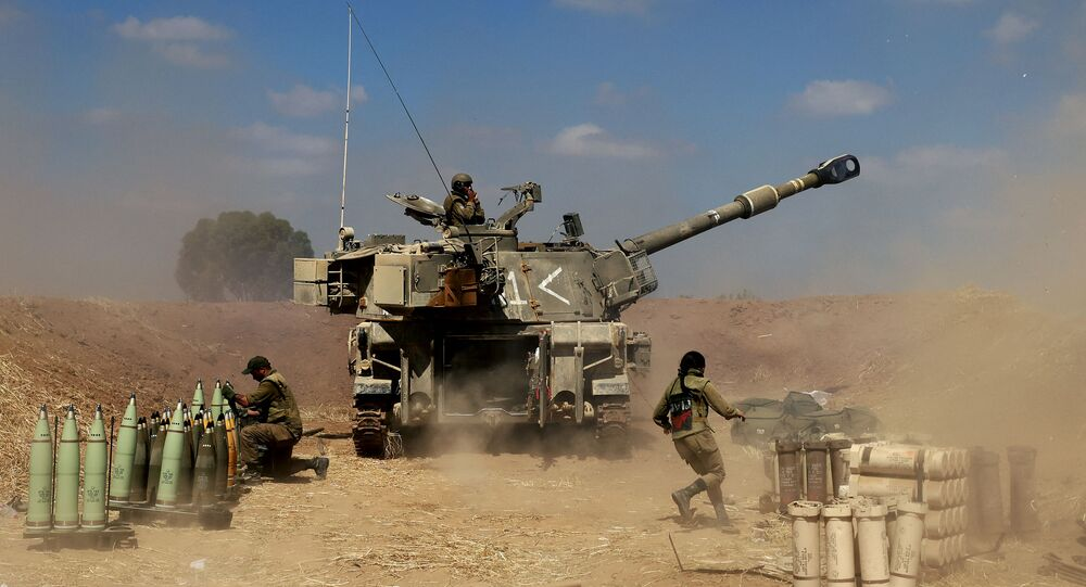 Israeli soldiers fire a 155mm self-propelled howitzer towards the Gaza Strip from their position near the southern Israeli city of Sderot on May 13, 2021. - Israel faced an escalating conflict on two fronts, scrambling to quell riots between Arabs and Jews on its own streets after days of exchanging deadly fire with Palestinian militants in Gaza.