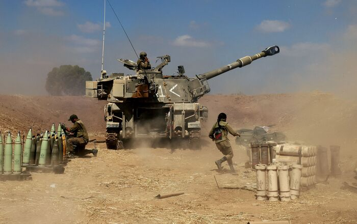 Israeli soldiers fire a 155mm self-propelled howitzer towards the Gaza Strip from their position near the southern Israeli city of Sderot on 13 May 2021. Israel faces an escalating conflict on two fronts, scrambling to quell riots between Arabs and Jews on its own streets after days of exchanging deadly fire with Palestinian militants in Gaza.