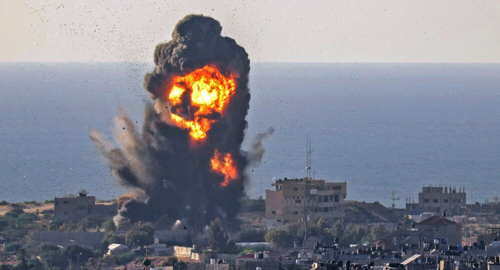 Smoke billows from an explosion following an Israeli air strike in Rafah in the southern Gaza Strip on 13 May 2021.