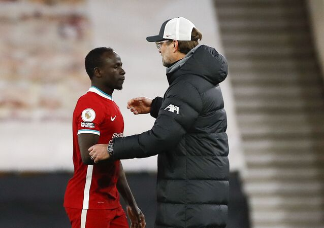 Liverpool's manager Jurgen Klopp congratulates Sadio Mane following the English Premier League soccer match between Wolverhampton Wanderers and Liverpool at Molineux Stadium in Wolverhampton, England, Monday, March. 15, 2021