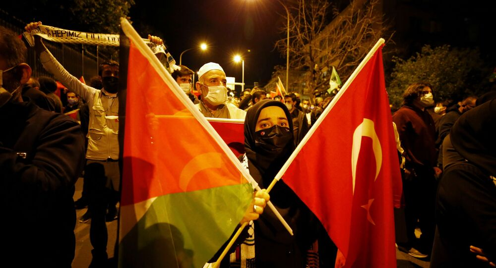 Demonstrators march with Turkish and Palestinian flags during a protest against Israel in Ankara, Turkey late May 10, 2021