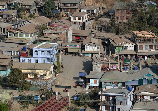 Residential houses on the Myanmar side are seen at Zokhawthar in the India's north-eastern state of Mizoram on 15 March 2021.