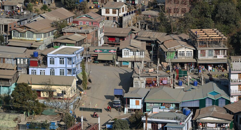 Residential houses on the Myanmar's side are seen at Zokhawthar in the India's northeastern state of Mizoram on March 15, 2021