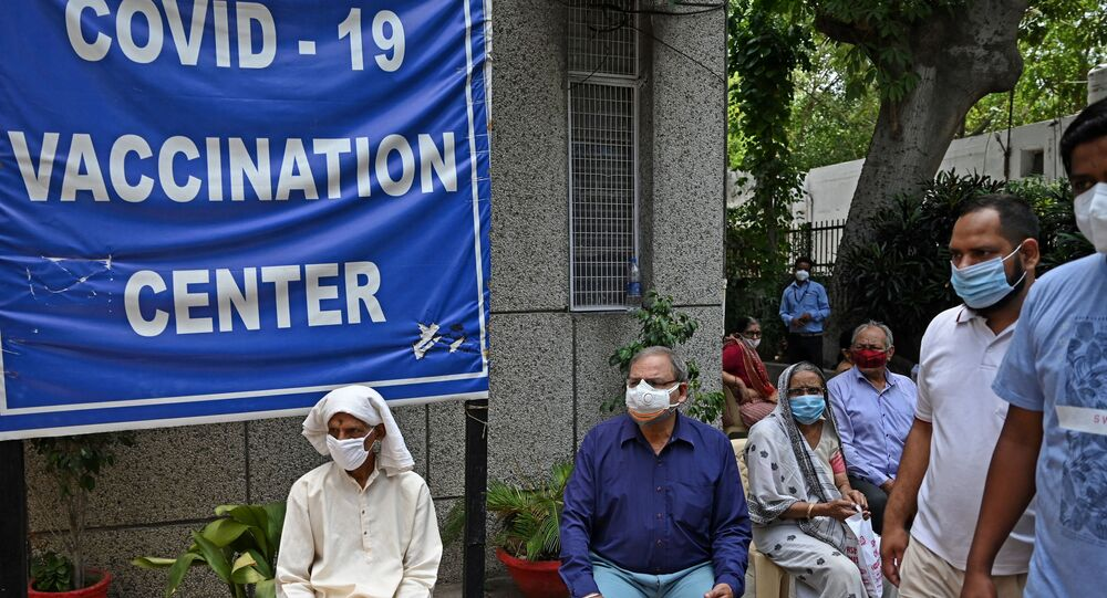 People wait to get themselves inoculated with the Covid-19 coronavirus vaccine at the urban primary health center in New Delhi on May 13, 2021