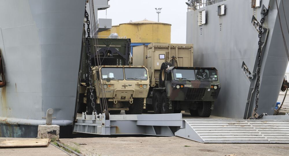 U.S. army vehicles disembark from a vessel at Albania's main port of Durres, Saturday, May 1, 2021.  Florida National Guard's 53rd Infantry Brigade Combat Team were being discharged from the USNS Bob Hope ahead of a two-week training of up to 6,000 U.S. troops in six Albanian military bases, as part of the Defender-Europe 21 large-scale U.S. Army-led exercise.