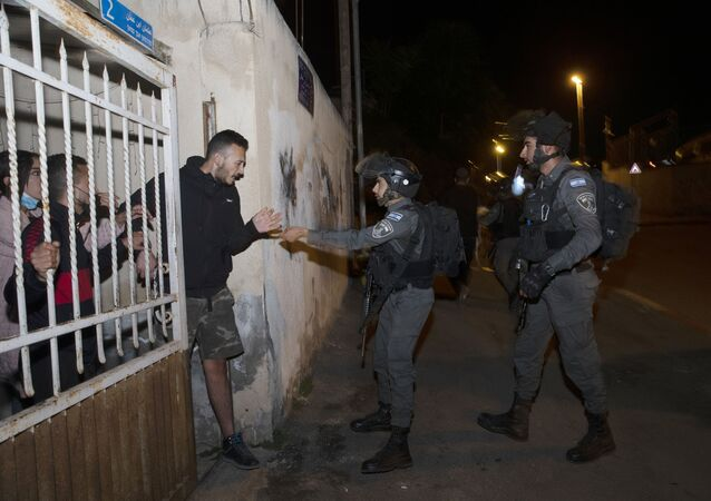 Israeli border police confront residents of a home in the Sheikh Jarrah neighborhood of East Jerusalem, where several Palestinian families face imminent eviction, Wednesday, May 12, 2021.