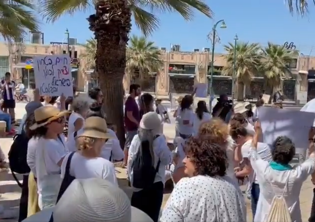 Screengrab of footage of demonstration by Jews and Arabs calling for peace in Israel after days of violence.