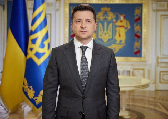 This handout photograph taken and released by The Ukrainian Presidential Press Service on April 20, 2021, shows Ukranian President Volodymyr Zelensky speaking during his late evening address in Kiev.