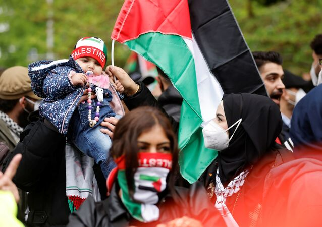 People take part in a protest in support of Palestinians, in Berlin, Germany, May 14, 2021.