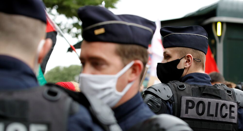 French police stand guard during a protest, following a flare-up of Israeli-Palestinian violence, in Paris, France, May 12, 2021