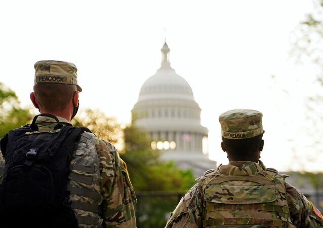Members of the National Guard patrol the U.S. Capitol grounds prior to U.S. President Joe Biden's first address to a joint session of the U.S. Congress in Washington, U.S., April 28, 2021.