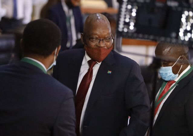 Former South African President Jacob Zuma (C) leaves the Commission of Inquiry into State Capture in Johannesburg during a break on November 16, 2020.