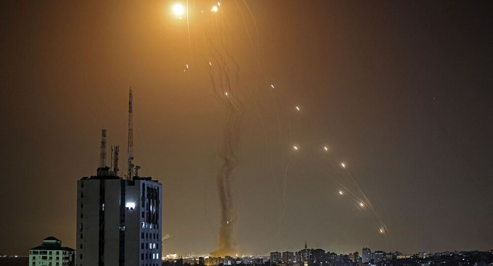A rocket launched from Gaza city controlled by the Palestinian Hamas movement, is intercepted by Israel's Iron Dome aerial defence system, on May 11, 2021.