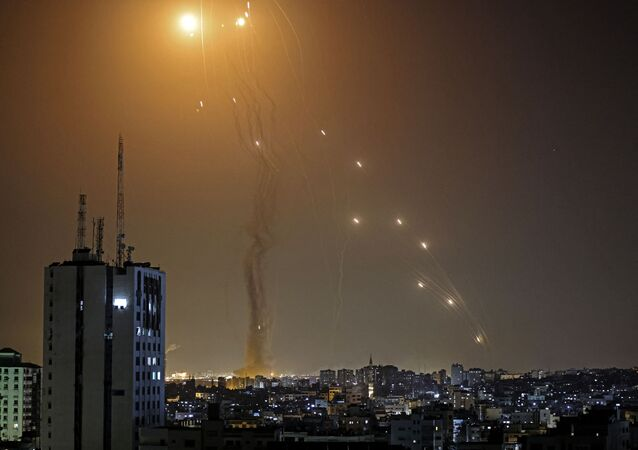 A rocket launched from Gaza city, controlled by the Hamas movement, is intercepted by Israel's Iron Dome aerial defence system, on 11 May 2021.