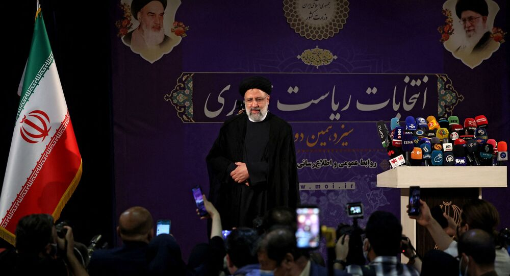 Iranian judiciary chief Ebrahim Raisi arrives to deliver a speech after registering his candidacy for Iran's presidential elections, at the Interior Ministry in capital Tehran, on May 15, 2021, ahead of the presidential elections scheduled for June.