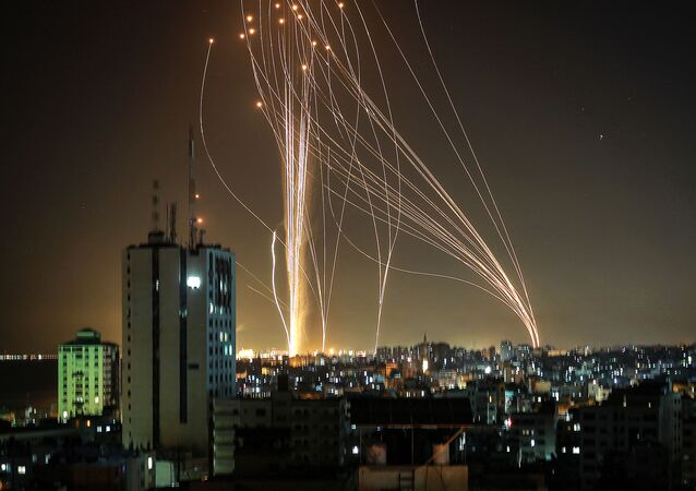 Rockets are launched from Gaza city, controlled by the Palestinian Hamas movement, in response to an Israeli air strike on a 12-storey building in the city, towards the coastal city of Tel Aviv, on 11 May 2021