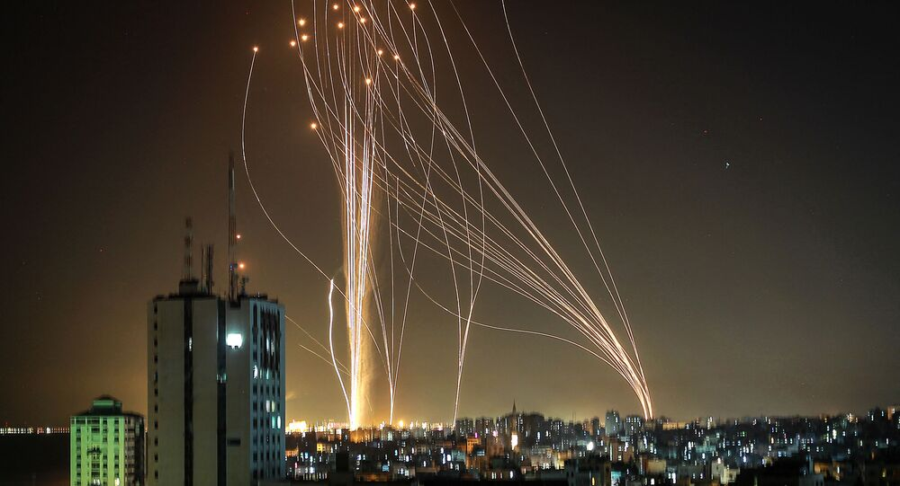 Rockets are launched from Gaza city, controlled by the Palestinian Hamas movement, in response to an Israeli air strike on a 12-storey building in the city, towards the coastal city of Tel Aviv, on 11 May 2021.