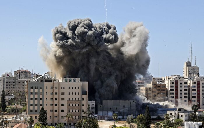 A thick column of smoke rises from the Jala Tower as it is destroyed in an Israeli airstrike in Gaza city controlled by the Palestinian Hamas movement, on May 15, 2021.