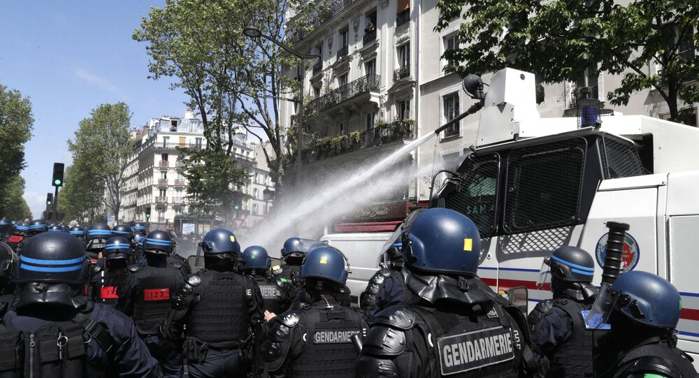 French riot mobile gendarmes and police officers walk toward protesters during a demonstration in solidarity with the Palestinians called over the ongoing conflict with Israel, in Paris on May 15, 2021.