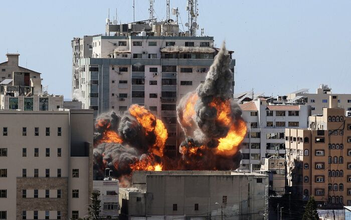 A ball of fire erupts from the Jala Tower as it is destroyed in an Israeli airstrike in Gaza city, controlled by Hamas.
