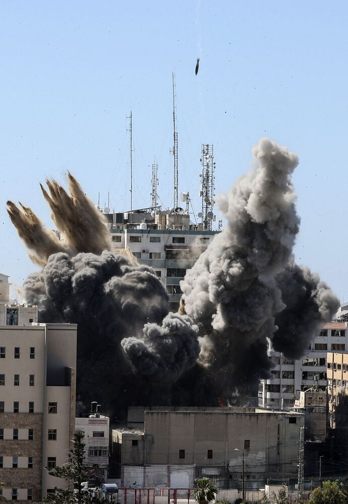 Smoke billows from a building housing various international media, including The Associated Press, after the Israeli airstrike.