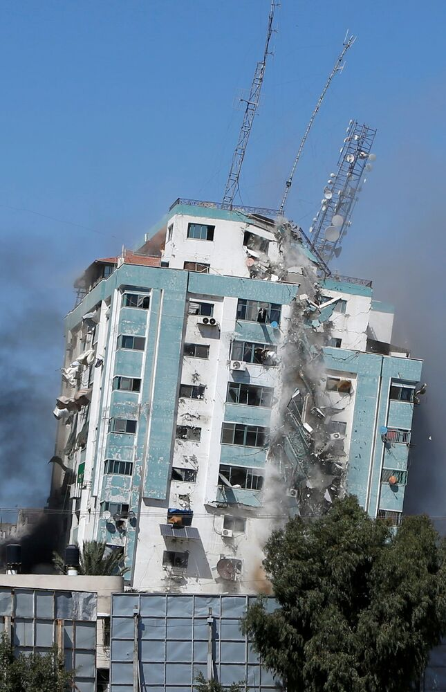 The tower collapses after the Israeli missile strike in Gaza.