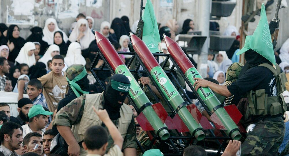 Masked Palestinian Hamas militants display their weapons during a parade in Gaza City. File photo.