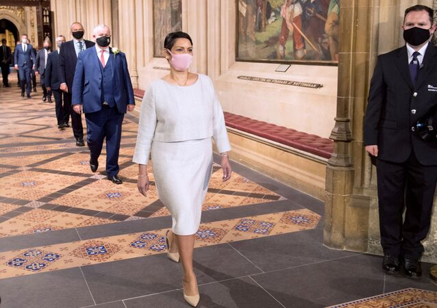 British Home Secretary Priti Patel processes through the Central Lobby from House of Lords after the Queen's Speech during the State Opening of Parliament in London, Britain May 11, 2021.