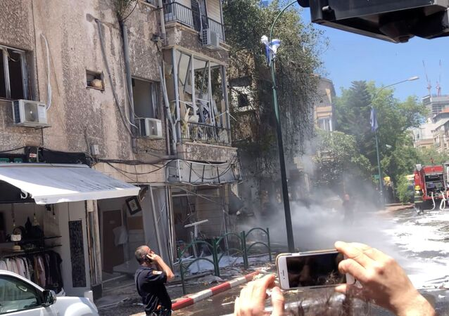 View of a building damaged by a rocket fired from Gaza, in Ramat Gan, Tel Aviv District, Israel May 15, 2021 in this still image obtained from social media video.