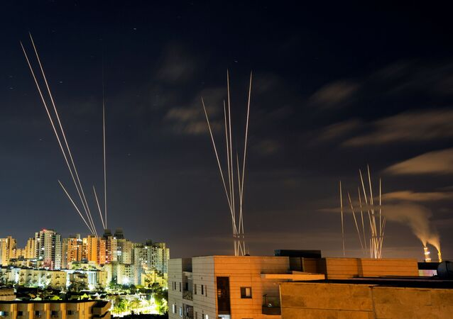 Streaks of light are seen as rockets are launched from the Gaza Strip towards central Israel as seen from Ashkelon, Israel May 16, 2021