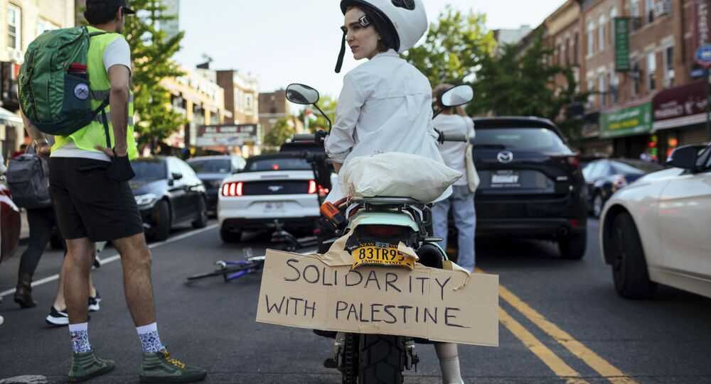 An Activist sits on her scooter as thousands of activists supporting Palestine converge in Brooklyn Saturday, May 15, 2021, in New York.