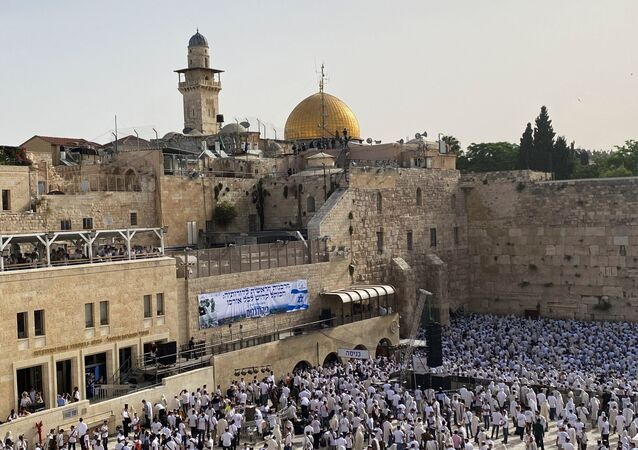 Jewish worshippers pray by the Western Wall, Judaism's holiest prayer site in Jerusalem's Old City May 10, 2021.