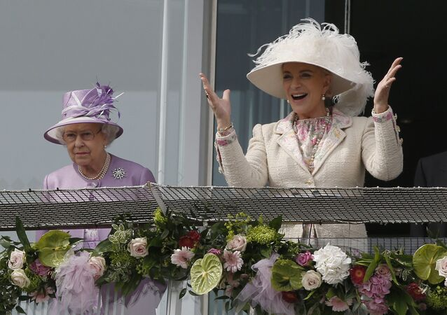 Britain's Queen Elizabeth II, left, looks on from the balcony as Princess Michael of Kent reacts to the winning horse at the end of Epsom Derby at Epsom racecourse, England, Saturday, 7 June 2014.
