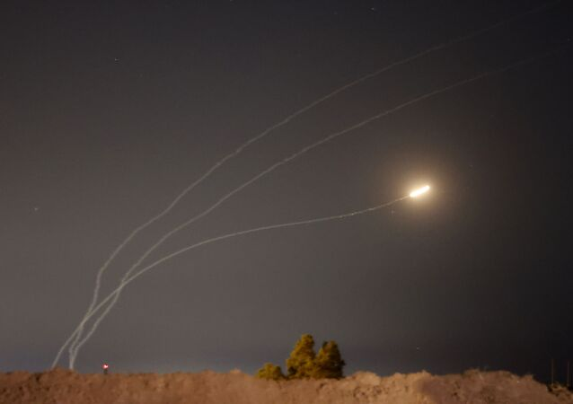 This picture taken from the southern Israeli city of Sderot shows rockets fired from the Gaza Strip being intercepted by the Israeli Iron Dome missile defence system, on May 16, 2021.