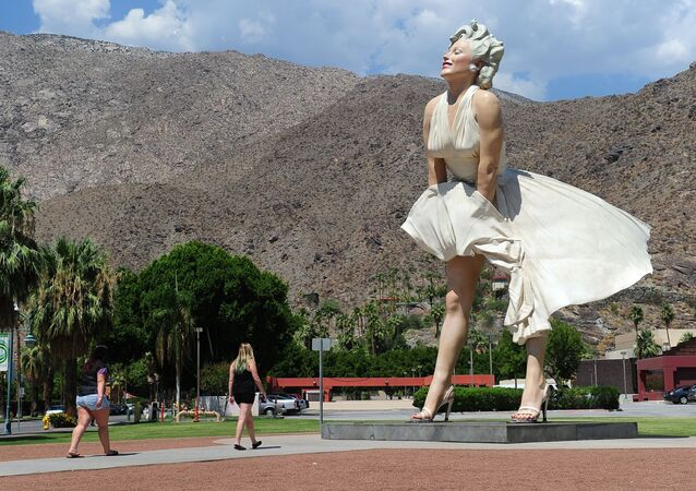 People visit the 'Forever Marilyn' statue of actress Marilyn Monroe in Palm Springs, California, on August 4, 2012, a day ahead of the 50th anniversary of Monroe's mysterious death.