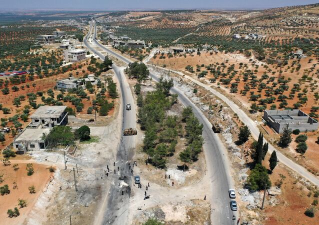 An aerial picture shows the site of an improvised explosive device which hit a joint Turkish-Russian patrol on the strategic M4 highway, near the Syrian town of Ariha in the rebel-held northwestern Idlib province, on July 14, 2020.