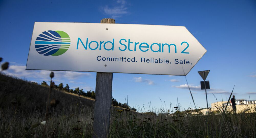 A road sign directs traffic towards the Nord Stream 2 gas line landfall facility entrance in Lubmin, north eastern Germany, on September 7, 2020.