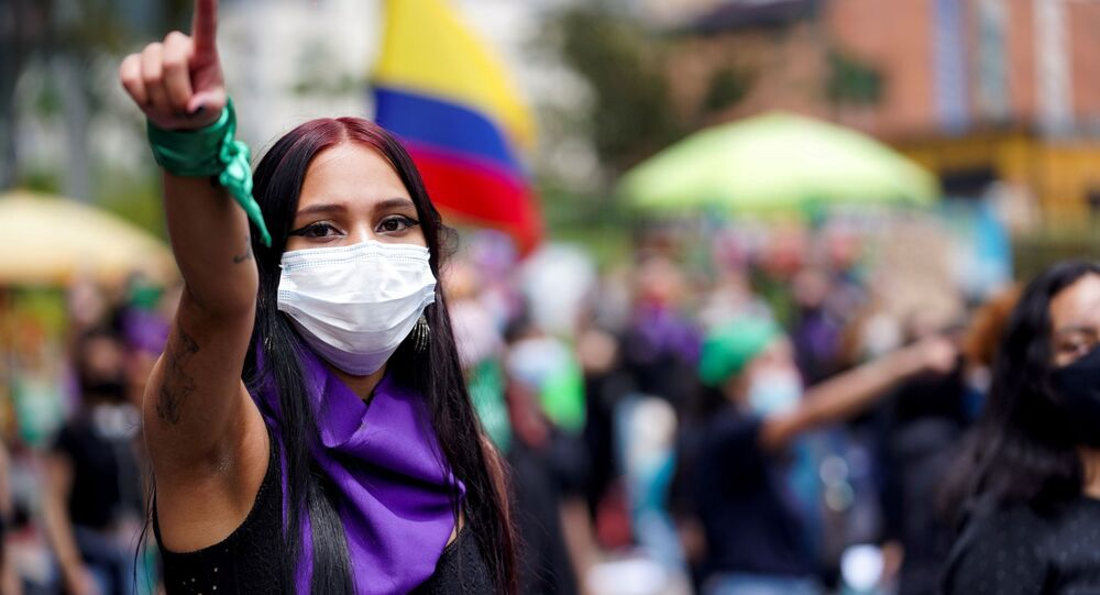 A woman gestures during a protest against sexual assault by the police and the excess of public force against peaceful protests, in Bogota, Colombia, May 15, 2021.